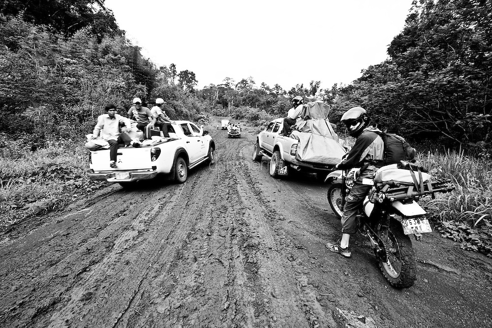 Waiting in line to run the mud hill gauntlet in Mondulkiri Province, Cambodia