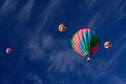 Hot air balloon float high above in a brillant Colorado sky