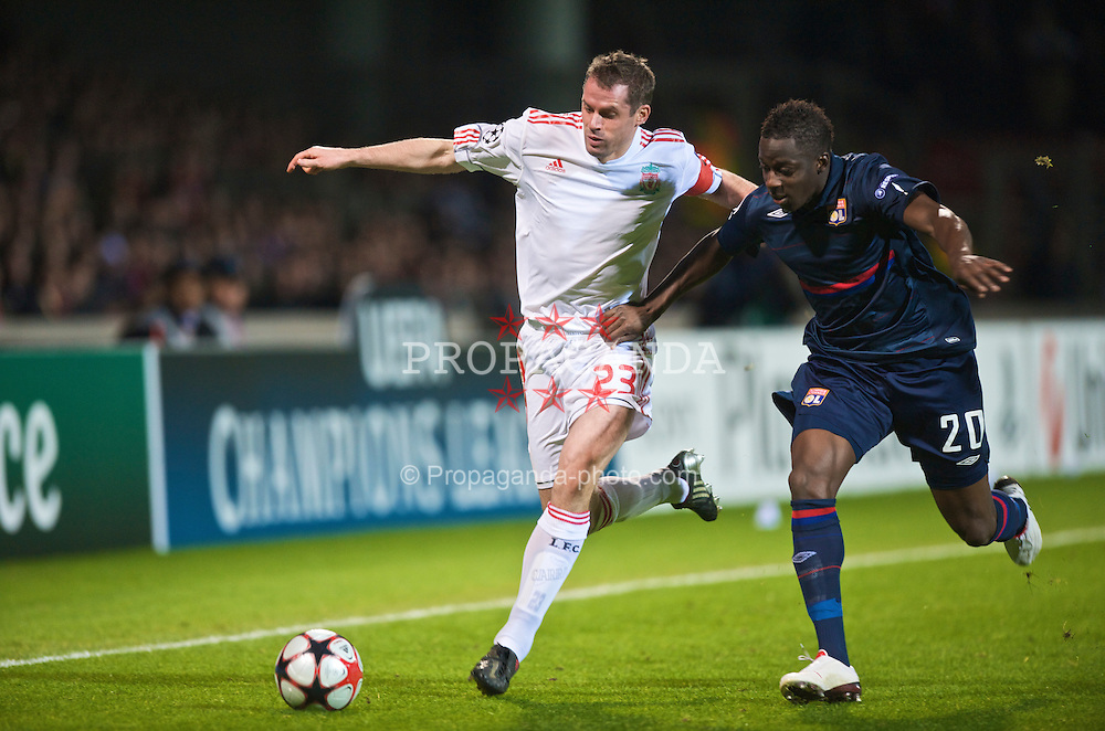 LYON, FRANCE - Wednesday, November 4, 2009: Liverpool's captain Jamie Carragher and Olympique Lyonnais' Aly Cissokho during the UEFA Champions League Group E match at Stade Gerland. (Pic by David Rawcliffe/Propaganda)
