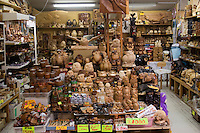 A gift shop sells traditional Ainu craftwork including carvings.