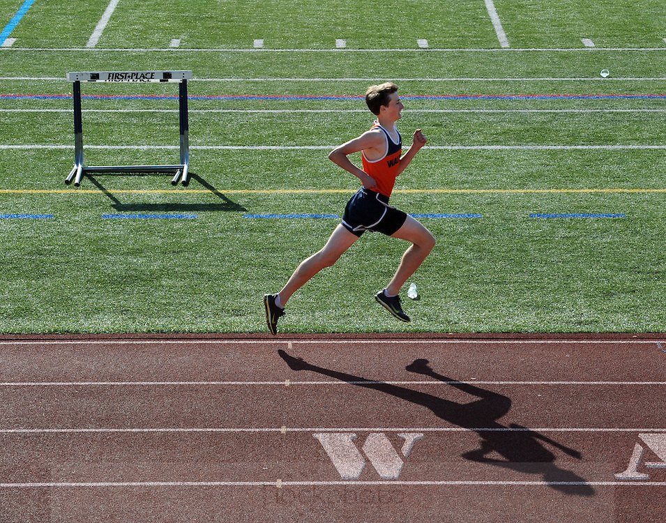Walpole H.S freshman Jonathan Benoit competes during the track meet against Norwood H.S., Wednesday, May 6, 2015.