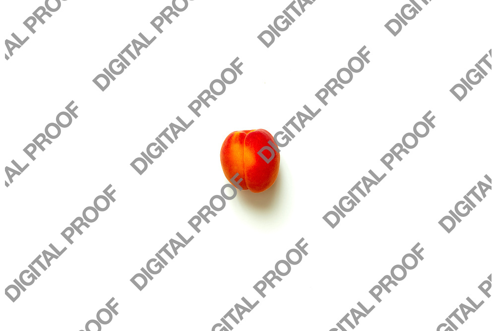 Lonely Apricot  isolated over a white background viewed from above, flatlay style