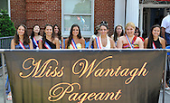 Miss Wantagh Pageant ceremony, a long-time Independence Day tradition on Long Island - with contestants sitting behind banner - is Wednesday, July 4, 2012, at Wantagh School, New York, USA. Hailey Orgass (center in yellow gown) was crowned Miss Wantagh 2012. Since 1956, the Miss Wantagh Pageant, which is not a beauty pageant, has crowned a high school student based mainly on academic excellence and community service.