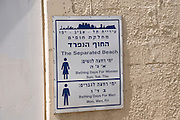 Israel, Tel Aviv, The Sheraton Beach a segregated beach with alternate days for men and women. The sign at the entrance to the enclosed area.