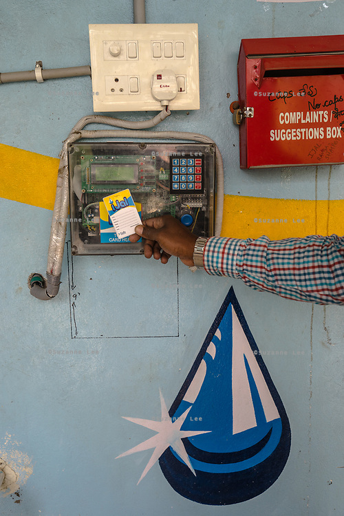 A customer uses a card at a Safe Water Network iJal station in Rangsaipet, in Waragal, Telangana, Indiia, on Saturday, February 9, 2019. Photographer: Suzanne Lee for Safe Water Network