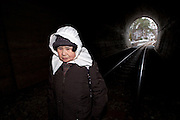 Taro village.Japanese woman walking on a train line that is followed by people who want to go to the temple that has been transformed to a shelter