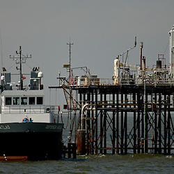 A support vessel dock with a well platform standing in the Gulf of Mexico off the coast of Louisiana, U.S., on Thursday, July 15, 2010. Photographer: Derick E. Hingle/Bloomberg