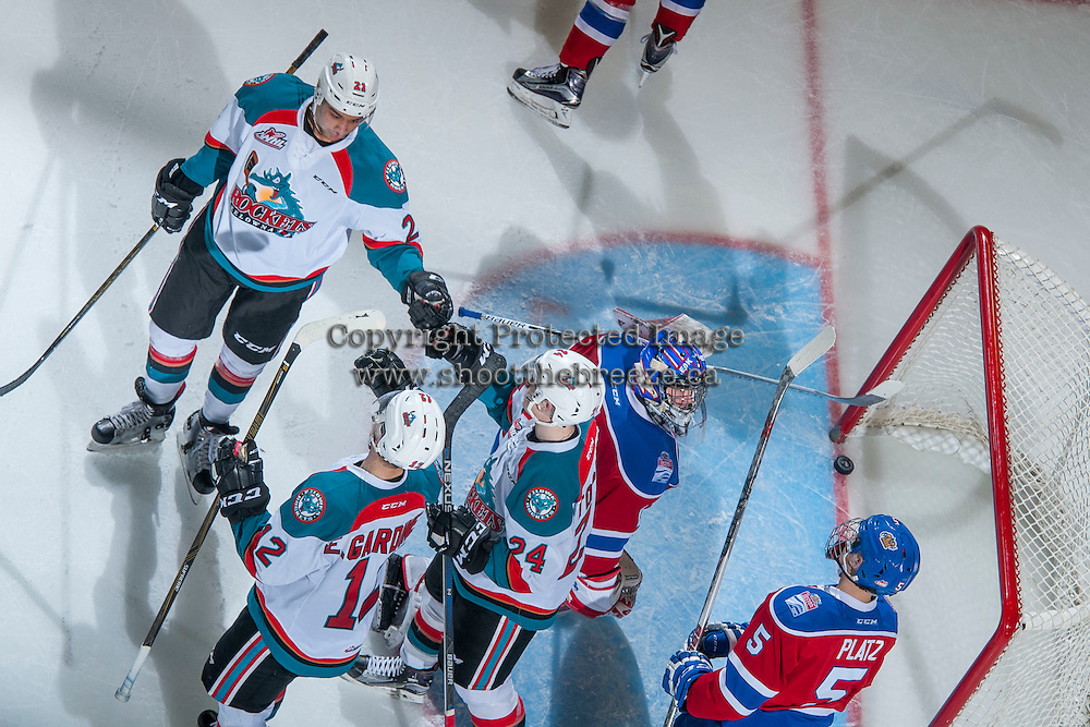 KELOWNA, CANADA - FEBRUARY 22: Devante Stephens #21 fist pumps Kyle Topping #24 of the Kelowna Rockets on his third period goal on Patrick Dea #1 of the Edmonton Oil Kings on February 22, 2017 at Prospera Place in Kelowna, British Columbia, Canada.  (Photo by Marissa Baecker/Shoot the Breeze)  *** Local Caption ***