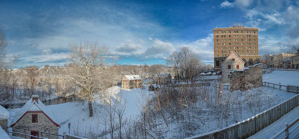 A multi shot panorama of the industrial quarter shot from the bridge the morning after a fresh snow.
