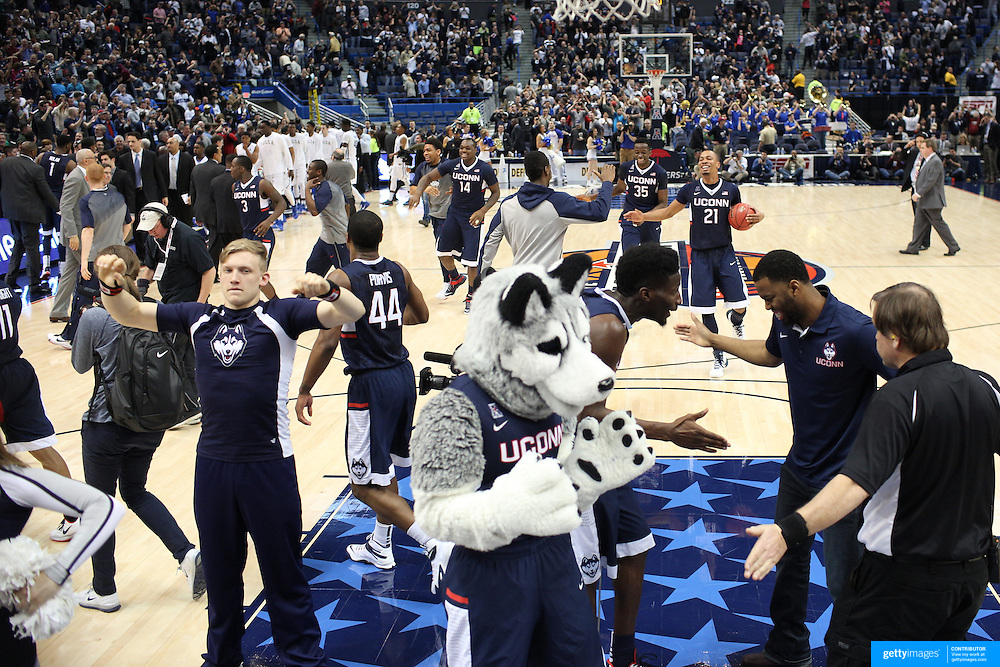 UConn celebrate victory at the end of the game during the UConn Huskies Vs Tulsa Semi Final game at the American Athletic Conference Men's College Basketball Championships 2015 at the XL Center, Hartford, Connecticut, USA. 14th March 2015. Photo Tim Clayton
