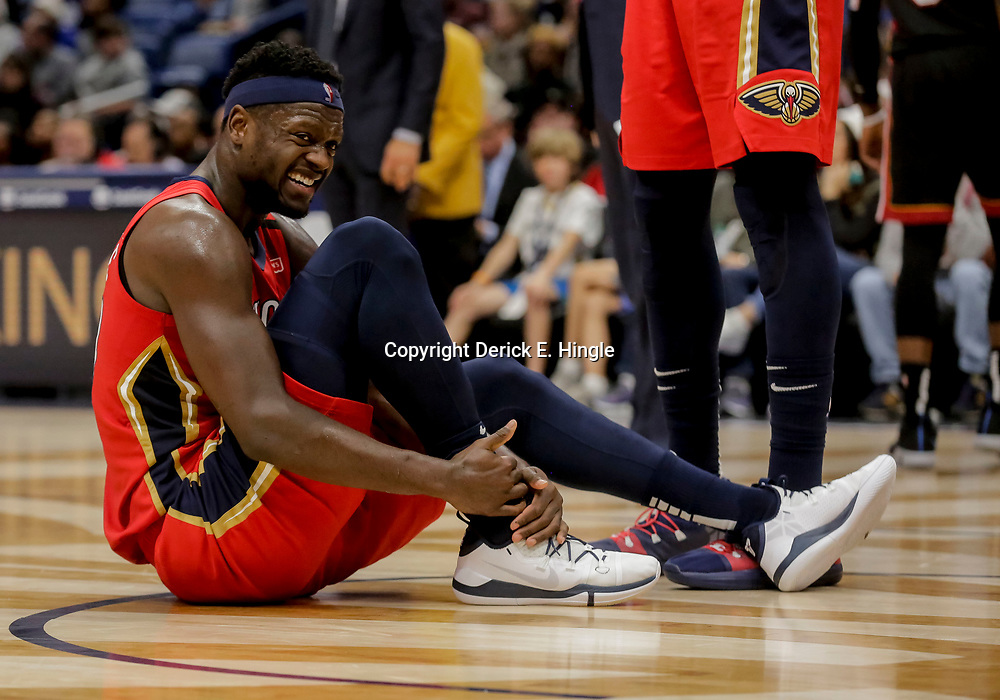 Dec 16, 2018; New Orleans, LA, USA; New Orleans Pelicans forward Julius Randle (30) grabs his ankle during the second half against the Miami Heat at the Smoothie King Center. Mandatory Credit: Derick E. Hingle-USA TODAY Sports
