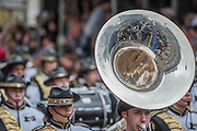 Marching bands on Whitehall pass the women of world war two memorial - The New Years day parade passes through central London form Piccadilly to Whitehall. London 01 Jan 2017