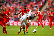 Leyton Orient defender Mavin Ekpiteta  (21) tussles with AFC Flyde forward Alex Reid (30) during the FA Trophy final match between AFC Flyde and Leyton Orient at Wembley Stadium on 19 May 2019.
