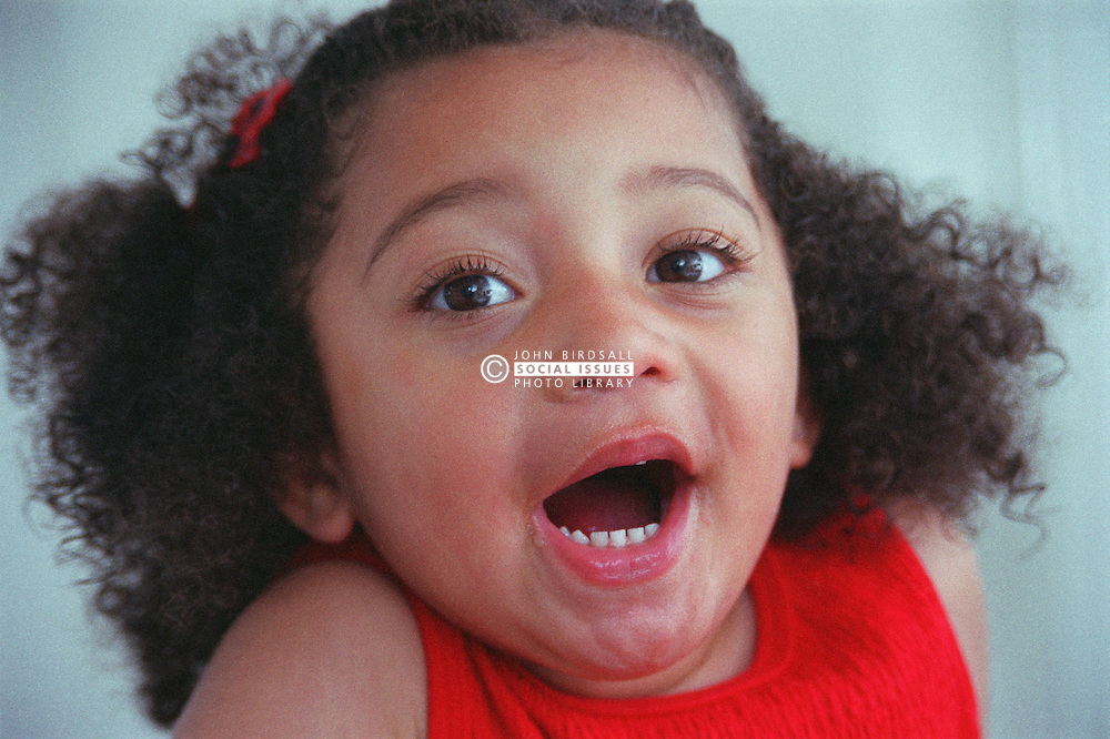 Portrait of young girl with mouth wide open,