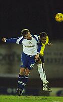 Photo: Paul Greenwood.<br />Bury v Hereford United. Coca Cola League 2. 30/01/2007. Bury's Glyn Hurst, left, betasTamika Mkandawire in  the air