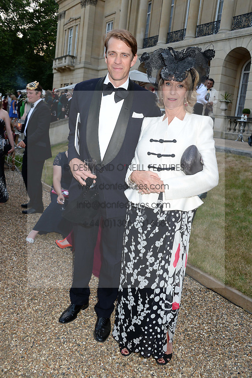 BEN ELLIOT and his mother ANNABEL ELLIOT at The Animal Ball in aid of The Elephant Family held at Lancaster House, London on 9th July 2013.