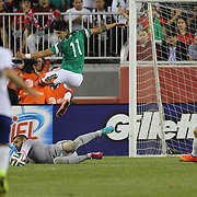 Goalkeeper Eduardo, Portugal saves at the feet of Alan Pulido, Mexico, during the Portugal V Mexico International Friendly match in preparation for the 2014 FIFA World Cup in Brazil. Gillette Stadium, Boston (Foxborough), Massachusetts, USA. 6th June 2014. Photo Tim Clayton