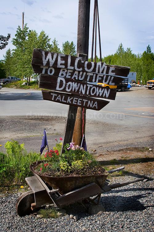 "Sign welcoming visitors to ""beautiful Downtown Talkeetna"", Alaska.."