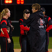 02 March 2018: San Diego State softball closes out day two of the San Diego Classic I at Aztec Softball Stadium with a night cap against CSU Northridge.San Diego State head coach Kathy Van Wyk talks with her infield as she makes a pitching change in the top of the third inning. The Aztecs dropped a close game 2-0 to the Matadors. <br /> More game action at sdsuaztecphotos.com