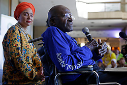 A frail looking but still delightful Archbishop Emeritus Desmond Tutu talks and reads a prayer to the gathered crowd while seated in a wheelchair during the annual Women's Day events that takes place yearly on Women's Day at Artscape Theatre Centre in Cape Town, South Africa. This event with Desmond Tutu and his wife Leigh took place shortly after the Women's Humanity Walk. This year's walk was an intergenerational celebration of the 60th anniversary of the 1956 Women's March where 20000 women marched on the Union Buildings in Pretoria, South Africa to protest for freedom and justice. Women from all walks of life and all religious and cultural backgrounds marched together in solidarity and in remembrance from the Slave Lodge to the Artscape Theatre in Cape Town, South Africa on the 9th August 2016.<br /> <br /> Photo by:   Mark Wessels / Real Time Images.