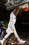 November 16th, 2013:  Colorado Buffaloes freshman guard Jaron Hopkins (23) throws down a ally-oop dunk in the first half of the NCAA Basketball game between the Jackson State Tigers and the University of Colorado Buffaloes at the Coors Events Center in Boulder, Colorado