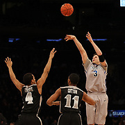 Doug McDermott, Creighton, in action shooting three during the Creighton Bluejays Vs Providence Friars basketball game during the Big East Conference Tournament Final at Madison Square Garden, New York, USA. 15th March 2014. Photo Tim Clayton