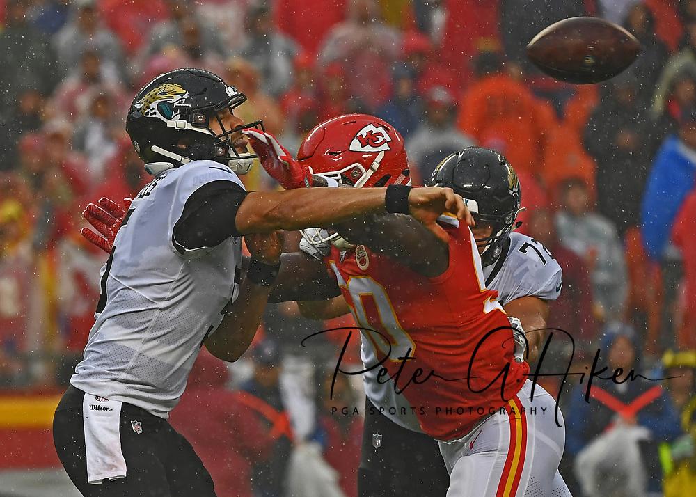 Linebacker Justin Houston #50 of the Kansas City Chiefs pressures quarterback Blake Bortles #5 of the Jacksonville Jaguars, during the first half at Arrowhead Stadium in Kansas City, Missouri.