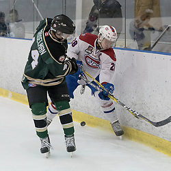 KINGSTON, ON - MAR 9,  2017: Ontario Junior Hockey League, playoff game between the Cobourg Cougars and Kingston Voyageurs, Cole Beckstead #25 of the Kingston Voyageurs battle for the puck along the boards Ryan Casselman #44 of the Cobourg Cougars during the 2nd period.<br /> (Photo by Ian Dixon/ OJHL Images)