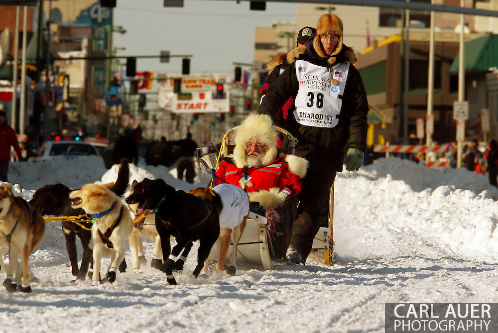 3/3/2007:  Anchorage Alaska -  Veteran Ryan Redington of Wasilla, AK, the son of Iditarod veteran, Raymie Redington and grandson of Iditarod co-founder, Joe Redington, Sr. heads out during the Ceremonial Start of the 35th Iditarod Sled Dog Race