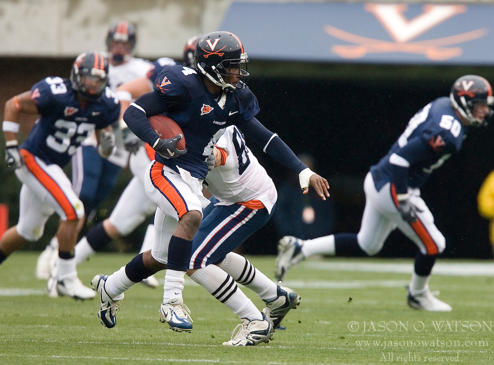 Virginia Cavaliers CB Vic Hall (4) returns an intercepted pass.  The University of Virginia Football Team played their Spring game at Scott Stadium in Charlottesville, VA on April 14, 2007.