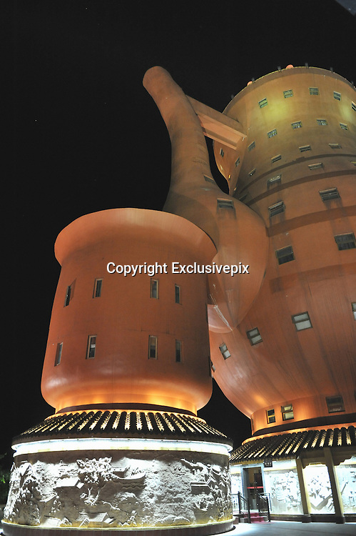MEITAN, CHINA - (CHINA OUT)<br /> <br />  Photo shows a teapot-shaped building, 48.2 meters in height, at a park on April 15, 2013 in Meitan County, Guizhou Province of China. ©Exclusivepix