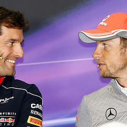 FORMULA 1 SANTANDER BRITISH GRAND PRIX Mark Webber and Jenson Button share a joke at press conference......(c) STEPHEN LAWSON | SportPix.org.uk