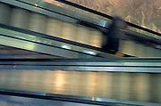 dark blurry figure on escalator