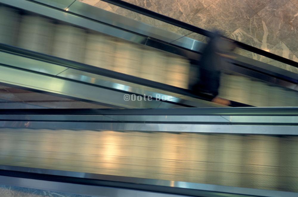 dark blurry figure on escalator