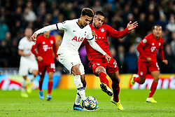 Dele Alli of Tottenham Hotspur is challenged by Corentin Tolisso of Bayern Munich - Rogan/JMP - 01/10/2019 - FOOTBALL - Tottenham Hotspur Stadium - London, England - Tottenham Hotspur v Bayern Munich - UEFA Champions League Group B.