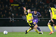 Kieron Morris of Tranmere Rovers (7) shoots past Jake Buxton of Burton Albion (5) during the EFL Sky Bet League 1 match between Burton Albion and Tranmere Rovers at the Pirelli Stadium, Burton upon Trent, England on 26 December 2019.