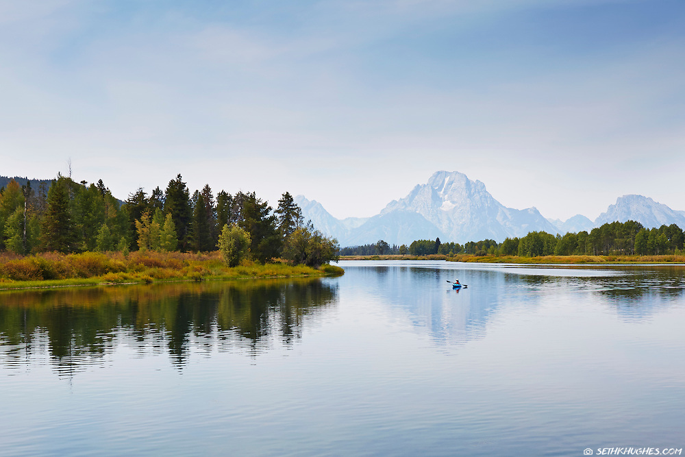 Paddling the calm waters of Oxbow Bend by kayak in Grand Teton National Park, Wyoming.
