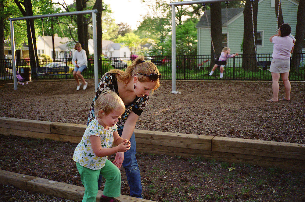Melissa Eich, 22, helps her daughter Madelyn Avery Eich, 2, to step down at the playground in Norfolk, Virginia on Saturday, April 17, 2010.