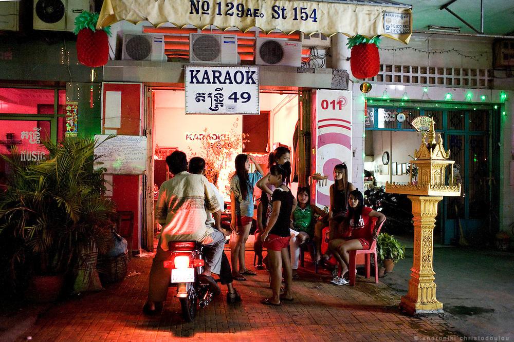 Karaoke bar in Phnom Penh. Karraoke bars, most times serve as a front for brothels often with underaged prostitutes.