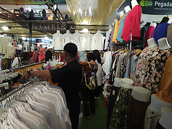 April 14, 2017 - Central Jakarta, Jakarta, Indonesia - Jakarta, Indonesia, 12 April 2017 : With Easter holiday following saturday and sunday off, people from Jakarta and some part of Indonesia visitted the most famous cheap textile mall in Jakarta called Thamrin City. Number of visitors doubled than usual day. Thamrin City known for the good quality textile with reasonable price, foreigner also love visited the mall. (Credit Image: ©  via ZUMA Wire)