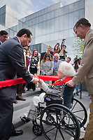 Mary Lousie cuts the ribbon at the opening celebration of the Anchorage Museum at Rasmuson Center, Anchorage, AK, May 29, 2009
