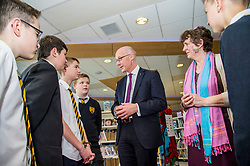 Pictured: John Swinney met Librarian Anne Ngabia who leads a team of students helpers in the library<br /> Education Secretary  John Swinney visited Grangemouth High School library today to launch the second round of bidding for a national funding programme aimed at improving school library services. <br /> <br /> <br /> Ger Harley | EEm 16 April 2018