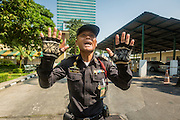"01 FEBRUARY 2014 - BANGKOK, THAILAND: A Thai police officer tries to stop voters who stormed the Din Daeng polling place after it was declared closed because anti-government protestors blocked access to the polls. Thais went to the polls in a ""snap election"" Sunday called in December after Prime Minister Yingluck Shinawatra dissolved the parliament in the face of large anti-government protests in Bangkok. The anti-government opposition, led by the People's Democratic Reform Committee (PDRC), called for a boycott of the election and threatened to disrupt voting. Many polling places in Bangkok were closed by protestors who blocked access to the polls or distribution of ballots. The result of the election are likely to be contested in the Thai Constitutional Court and may be invalidated because there won't be quorum in the Thai parliament.    PHOTO BY JACK KURTZ"