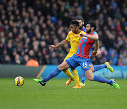 Crystal Palace's Mile Jedinak battles for the ball with Liverpool's Raheem Sterling - Photo mandatory by-line: Alex James/JMP - Mobile: 07966 386802 - 23/11/2014 - Sport - Football - London -  - Crystal palace  v Liverpool - Barclays Premier League