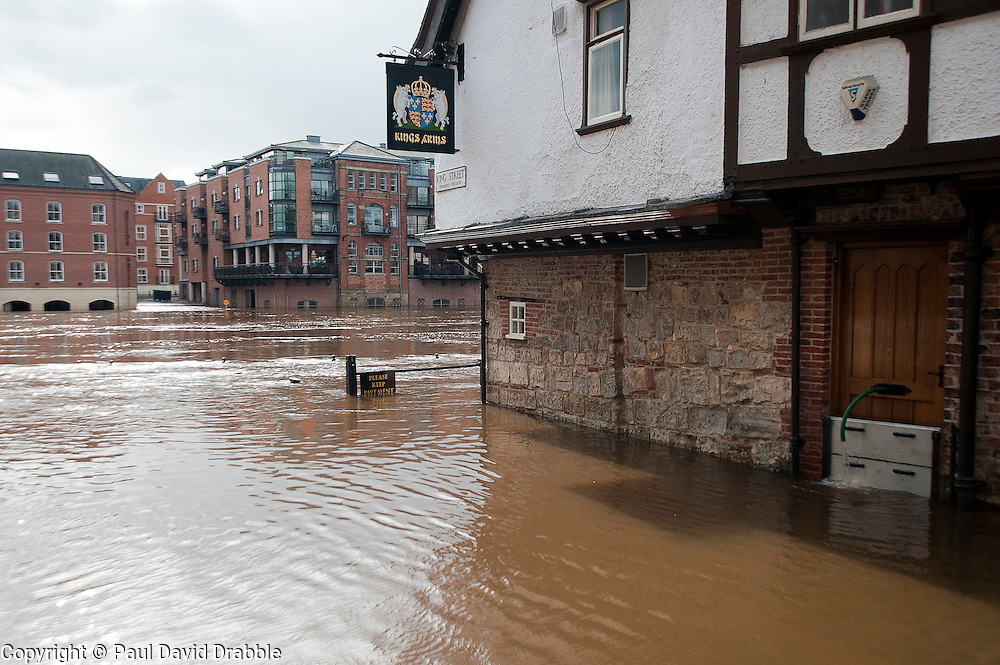 On the day the environment Agency announce there is no longer a drought in Yorkshire, this is the view from the Kings street York looking across the river Ouse toward Queen Staith where river has risen flooding local roads and businesses after the wettest April since records began. .11  May 2012.Image © Paul David Drabble