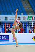 """Jerman Aja during hoop routine at the International Tournament of rhythmic gymnastics """"Città di Pesaro"""", 10 April, 2015. Jerman Aja born 20 August 1999 in Ljubljana, is a Slovenian rhythmic gymnast.<br /> This tournament dedicated to the youngest athletes is at the same time of the World Cup."""