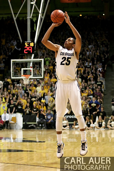 January 24th, 2013 Boulder, CO - Colorado Buffaloes sophomore guard Spencer Dinwiddie (25) elevates for a three point shot attempt during the NCAA basketball game between the Stanford Cardinal and the University of Colorado Buffaloes at the Coors Events Center in Boulder CO