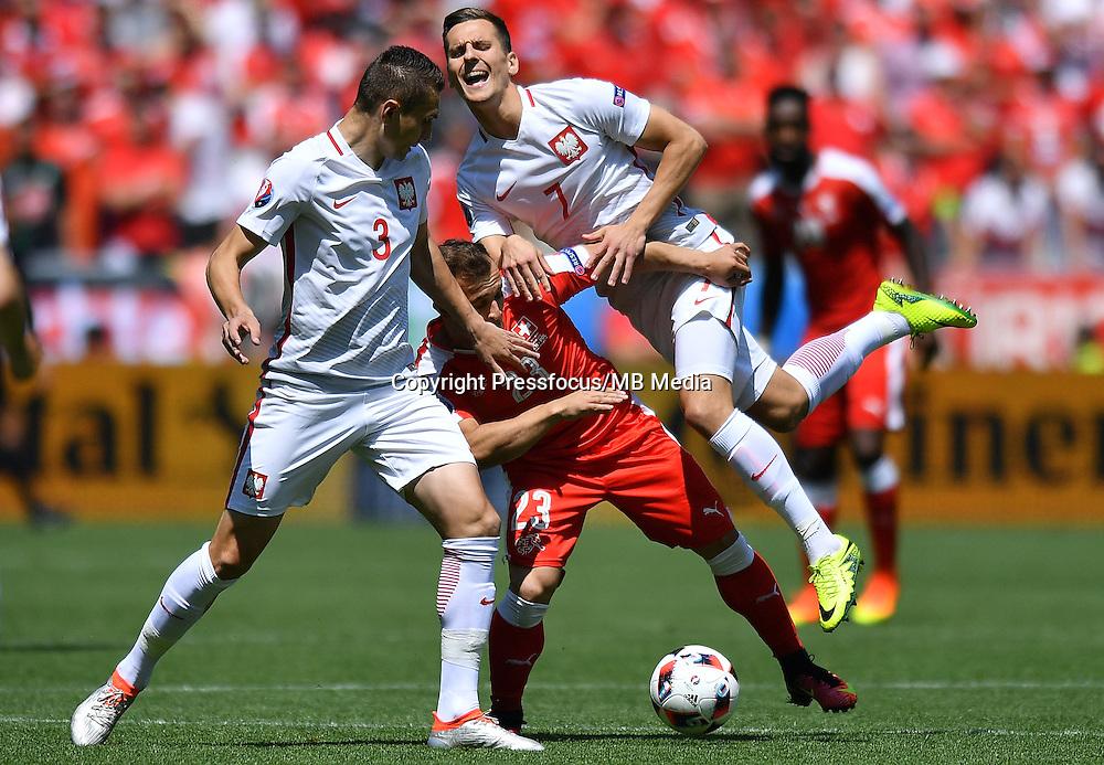 2016.06.25 Saint-Etienne<br /> Pilka nozna Euro 2016<br /> mecz 1/8 finalu Szwajcaria - Polska<br /> N/z Artur Jedrzejczyk Xherdan Shaqiri Arkadiusz Milik<br /> Foto Lukasz Laskowski / PressFocus<br /> <br /> 2016.06.25<br /> Football UEFA Euro 2016 <br /> Round of 16 game between Switzerland and Poland<br /> Artur Jedrzejczyk Xherdan Shaqiri Arkadiusz Milik<br /> Credit: Lukasz Laskowski / PressFocus