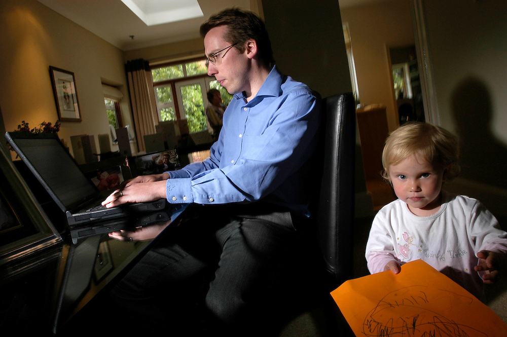 Julian Oldfield, Personal Injury Solicitor, at home with his family and computer in Kingston in Surrey..Photograph©Steve Forrest