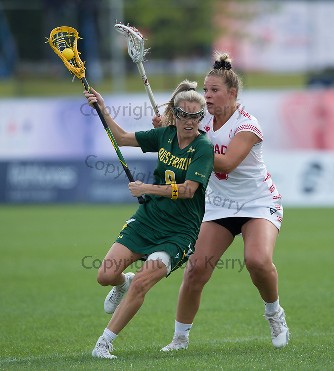 Canada's Kay Morrisette (R) challenges with Australia's Sarah Mollison during their opening game of the 2017 FIL Rathbones Women's Lacrosse World Cup, at Surrey Sports Park, Guildford, Surrey, UK, 13th July 2017.